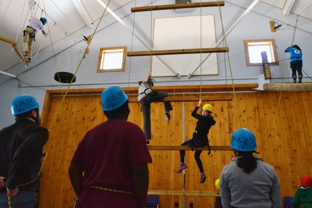 Camp Merrowvista college students climb dangling duo