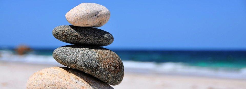 Slider Balance mit Steinen und Strand