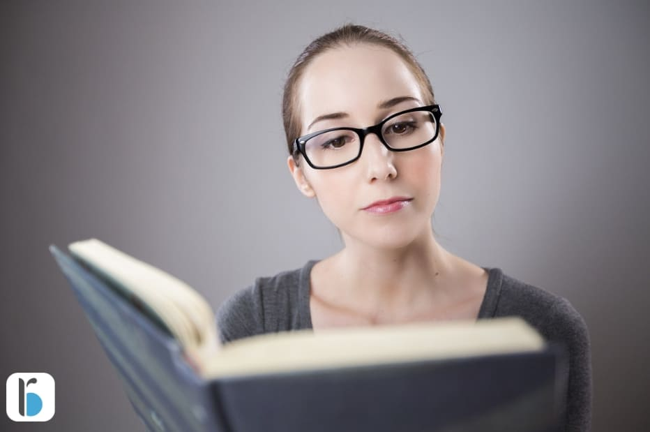 Develop a successful mindset. A woman reading a book.