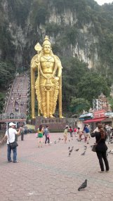 Batu Caves, Malaysia. Batu Caves has GINORMOUS statue. then you can ascend the stairs to the cave. it has more or less 196 steps (one-way) or 392 steps (round trip). so exhausted -_- it has Dark Cave exploration too where you can observe bats and dark creatures but you gotta pay, idk, 40 MYR or something.