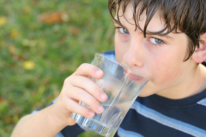boy drinking a glass of water Image source -- https://www.flickr.com/photos/21178966@N04/4976984968/sizes/o/