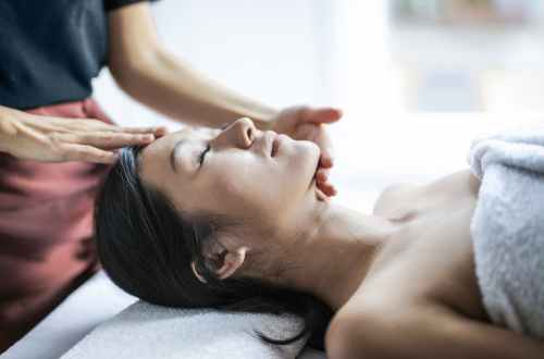 selective focus photo of woman getting a head massage