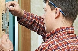 Locksmith installing security locks