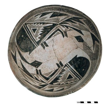 A Mimbres Style III bowl with designs showing intertwined snakes and fish.  From the Ronnie site, in southwestern New Mexico