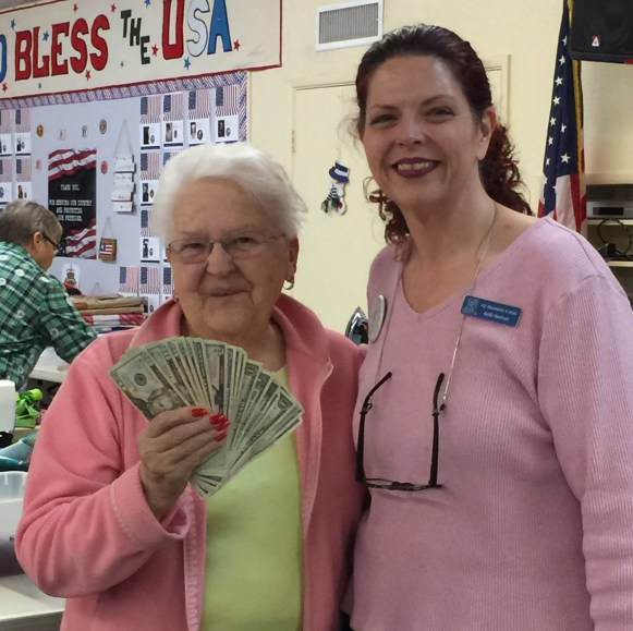 Lois G looking cute as button with her big winnings from the 50/50 raffle.