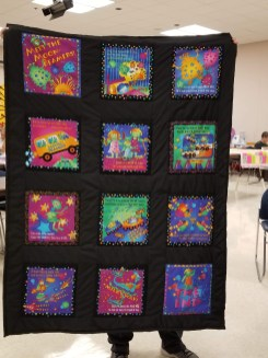 Carol put this cute quilt together with book panels. So fun and cheerful!