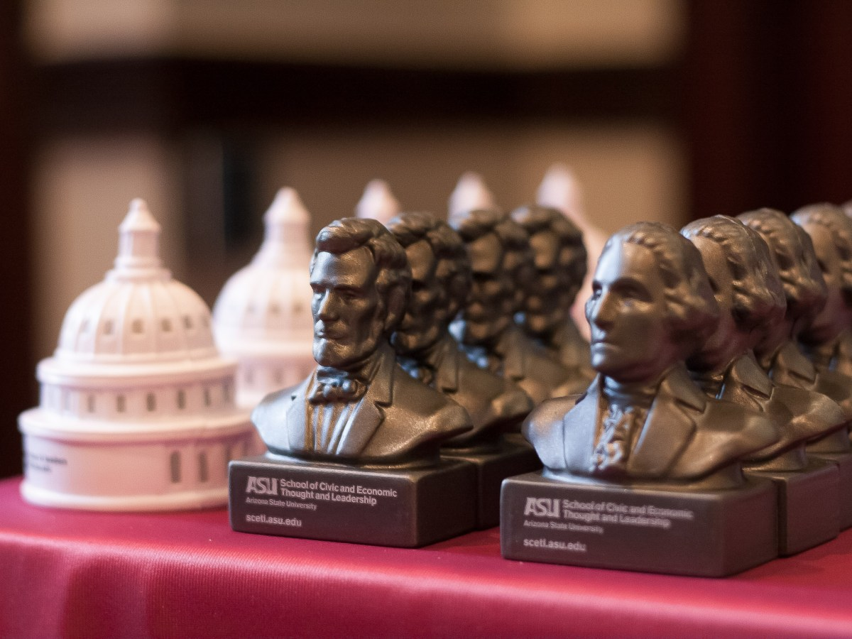 Novelty foam-rubber U.S. Capitol dome replicas and busts of Abraham Lincoln and George Washington were among the trinkets given away at an April 2 event hosted by Arizona State University's School of Civic and Economic Thought and Leadership on the topic of free speech on campus. (Photo by Evan Wyloge/Arizona Center for Investigative Reporting)