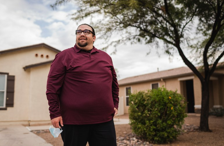 Daniel Sestiaga is shown outside his home in Tucson, Arizona, on Sept. 17, 2021. After he was first diagnosed with Valley fever in 2020, Sestiaga's infection would later spread throughout his body, turning into the most severe form of the disease known as disseminated Valley fever. Photo by Alberto Mariani for AZCIR