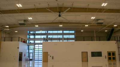 Inside shot of finished apoxy floors of the Triple C hanger at Scottsdale Airport with the bi-fold door closed