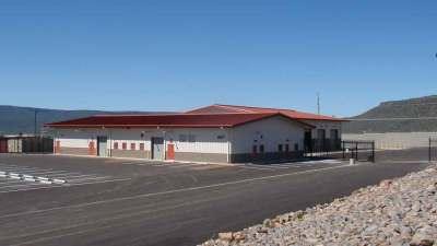 Finished building and wash bay building of Whiteriver District Transportation Center on a sunny day