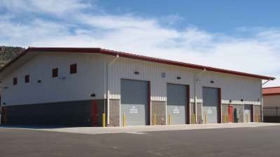 Three roll up doors for the wash bays of Whiteriver district transportation center