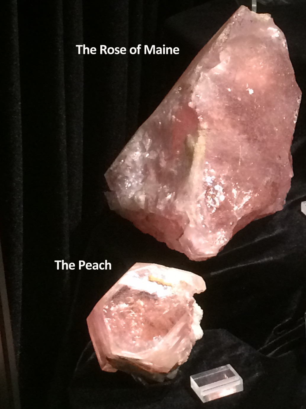 "Figure 8a. ""The Rose of Maine"" and ""The Peach,"" morganite beryl from the Bennett Quarry, Maine"