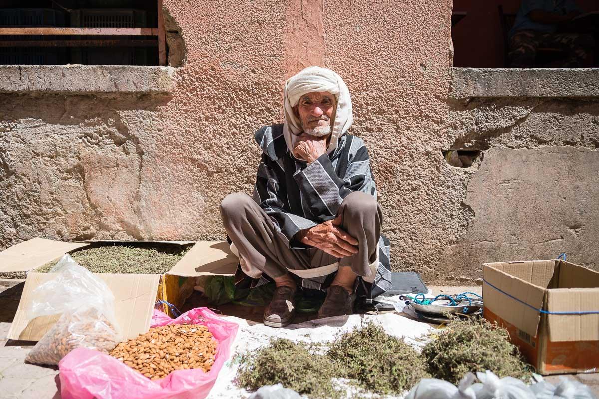 Man selling herbs during Rose Festival, Kaaat Mgouna, Morocco