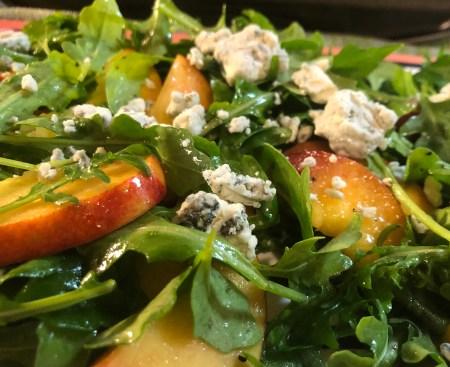 Nectarine and blue cheese arugula salad