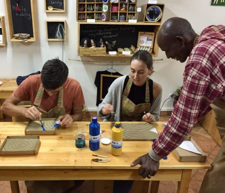 Imigongo Guest Painters with Artisan Alexi