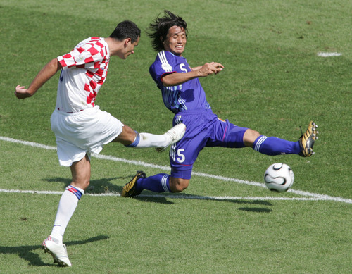 Japan's Tsuneyasu Miyamoto challenges Croatia's Marko Babic in Nuremberg