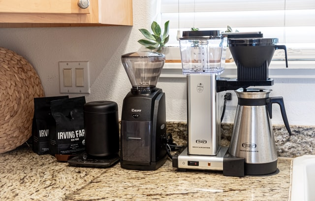 Blenders and a coffee machine on a working surface in the kitchen