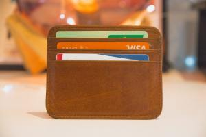 A wallet containing credit cards. When it comes to affordability in the rural Arizona vs rural California clash, Arizona wins.