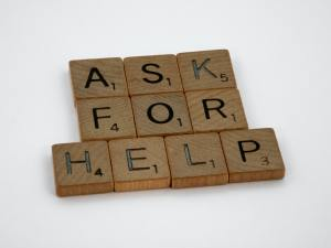 an image of wooden block with writing that says ask for help