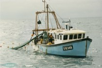 The Falmouth registered 'Southover Scorpio' FH 388 having just hauled is about to release the catch onto the deck. The fishery officer on the right is measuring the mesh with a net gauge. (© Glyn Richards. GCR_1_07)