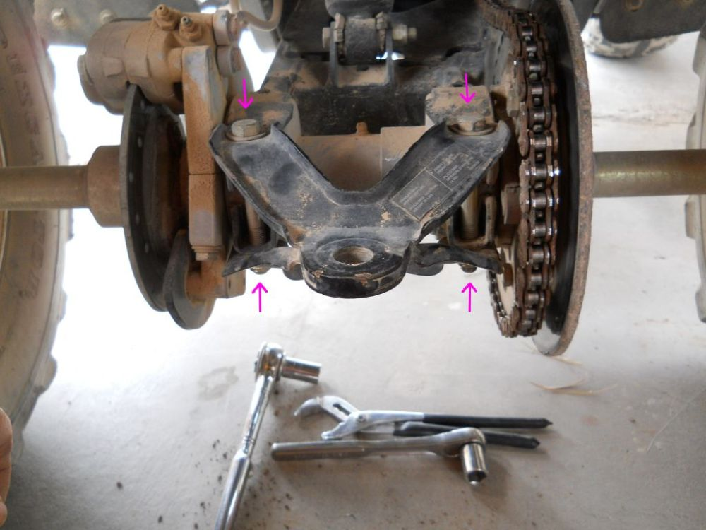 medium resolution of next on the left side on the bottom of the brake caliper there are two nuts you need to loosen those once they are loose you are ready to rotate the