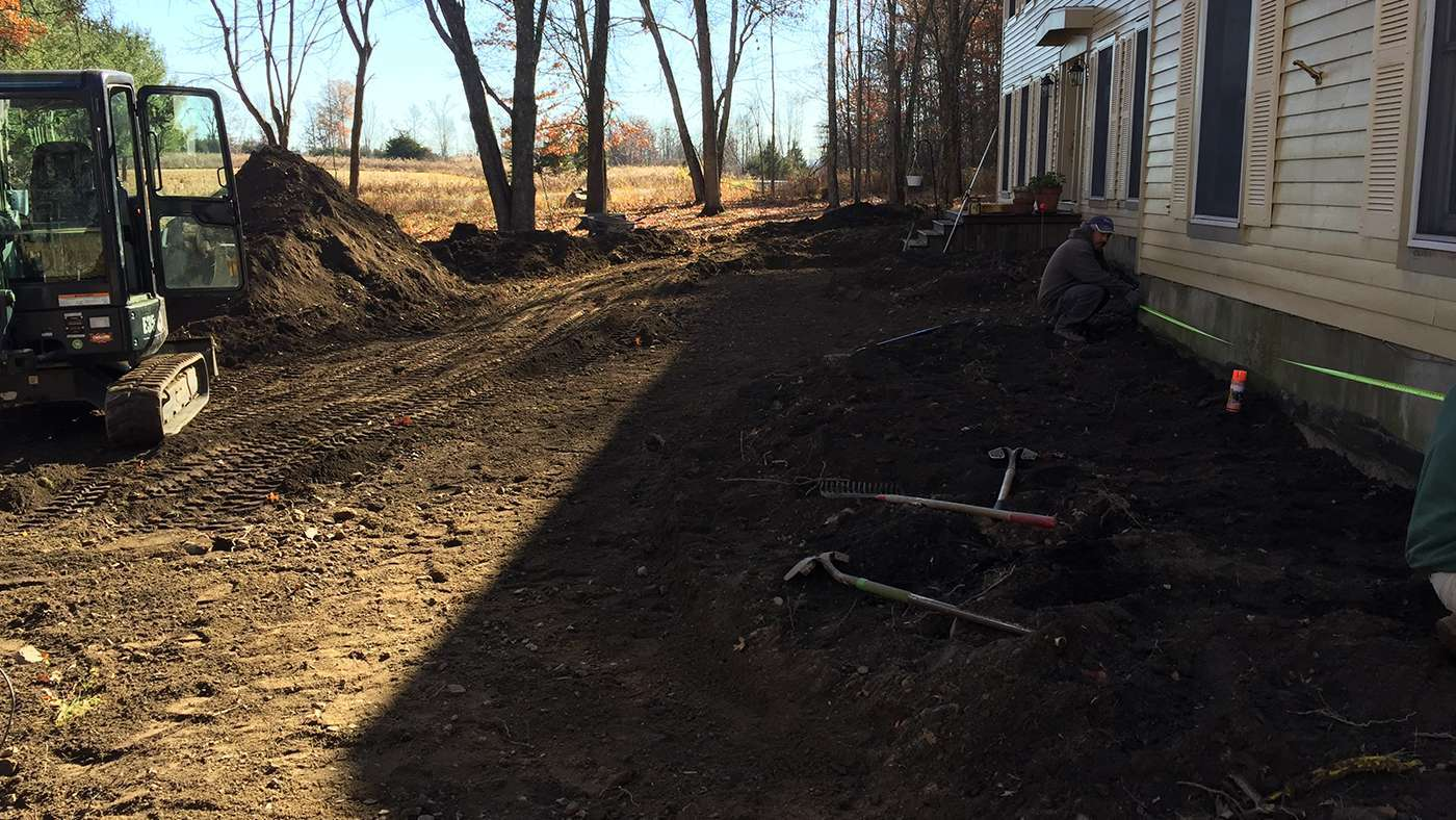 Leveling ground to start setting up the base for walkway and landscape in New Paltz NY
