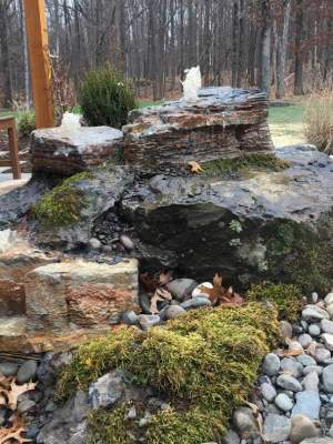 A pondless waterfall by a sitting area in this home New Paltz NY