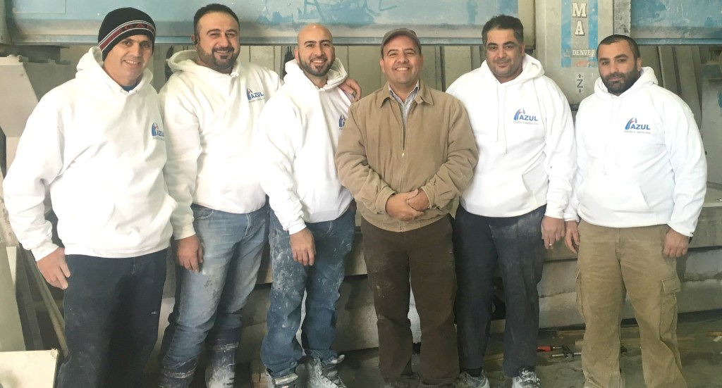 Owner (Mr.Maan Yoqoob) centre and Staff