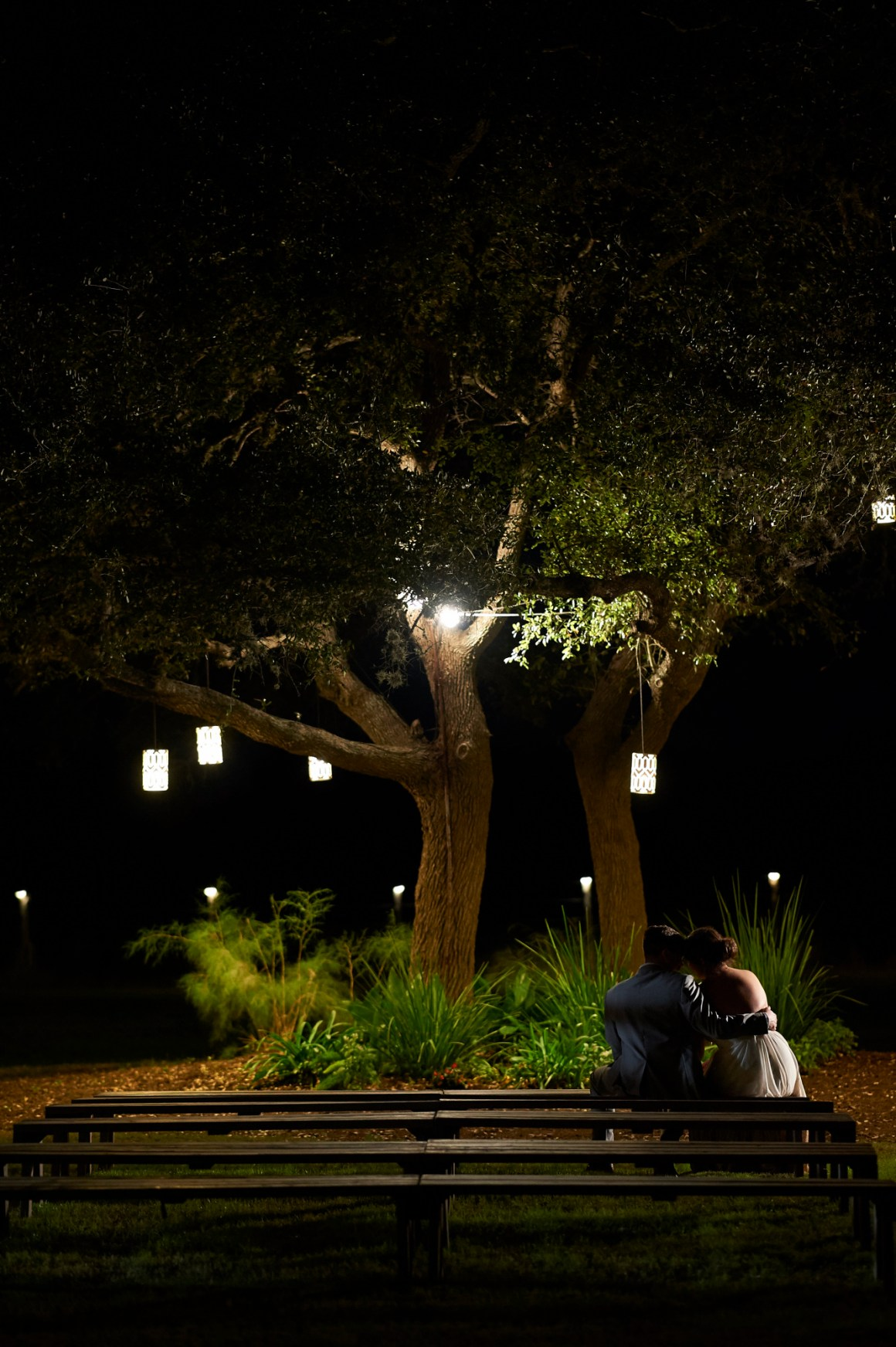 Bride and Groom Cuddling under a Tree, Wedding, Stonehouse Villas, Dripping Springs