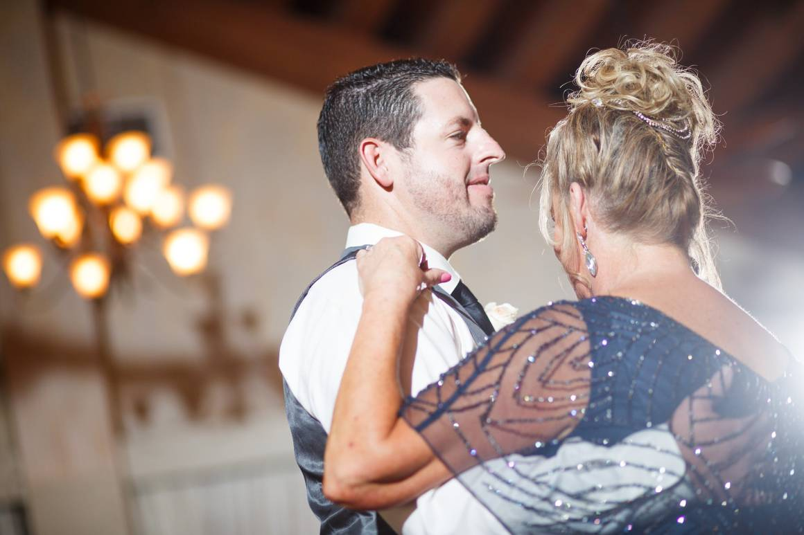 Antebellum Oaks Wedding - Austin Wedding Photographer - Jacob and Katie - hill country wedding - groom dancing with mother - wedding reception - wedding dance floor -