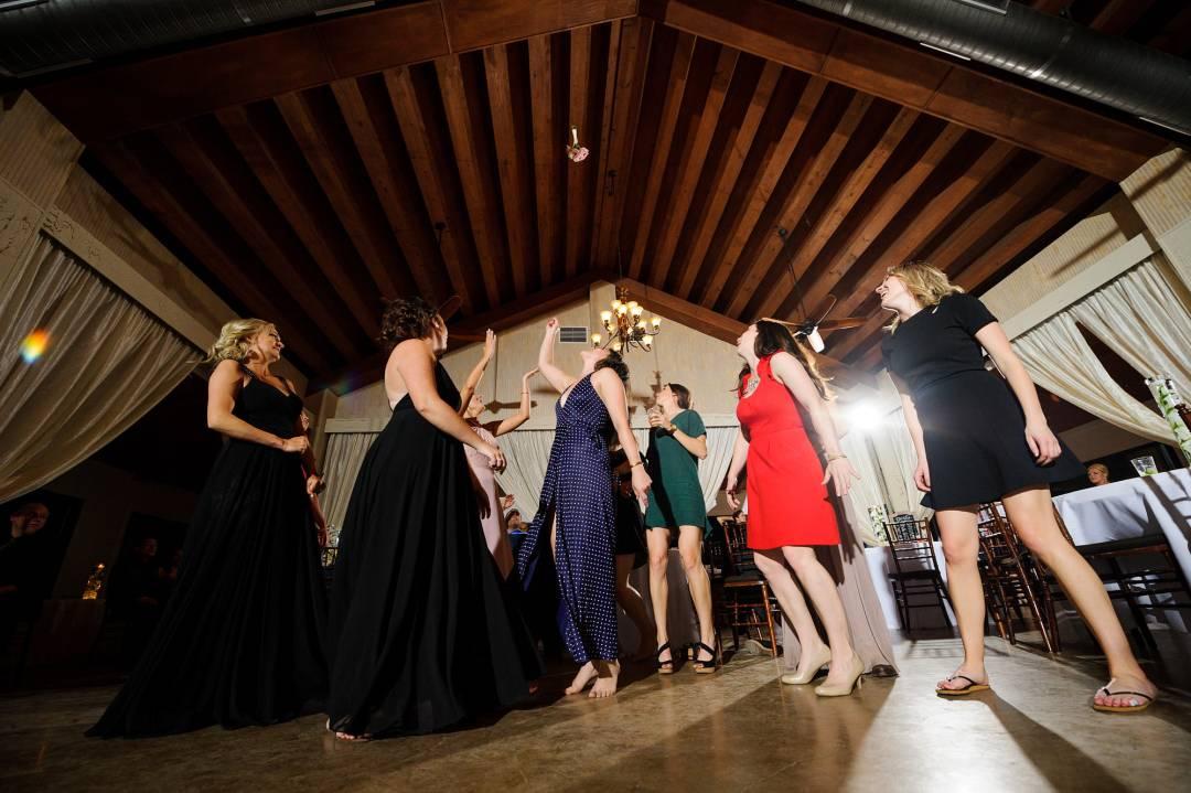 Antebellum Oaks Wedding - Austin Wedding Photographer - Jacob and Katie - wedding reception - bride throwing flowers