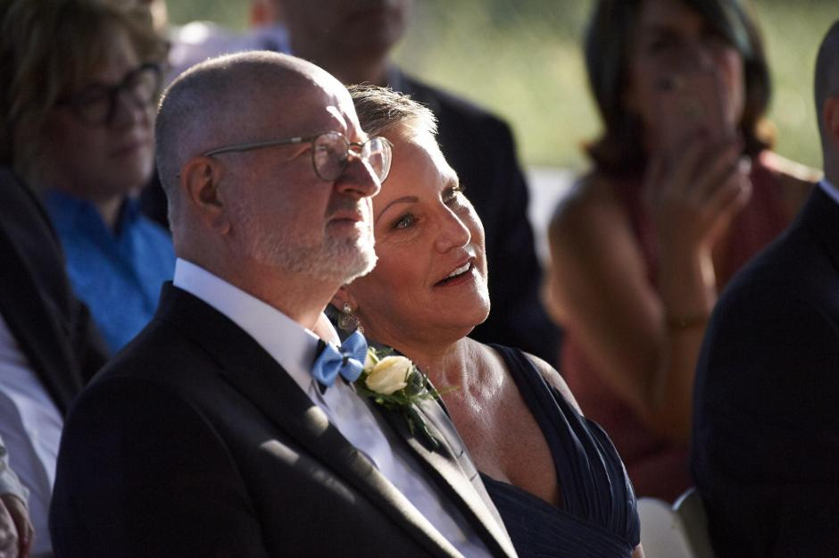 The bride's parents look on proudly during the wedding.