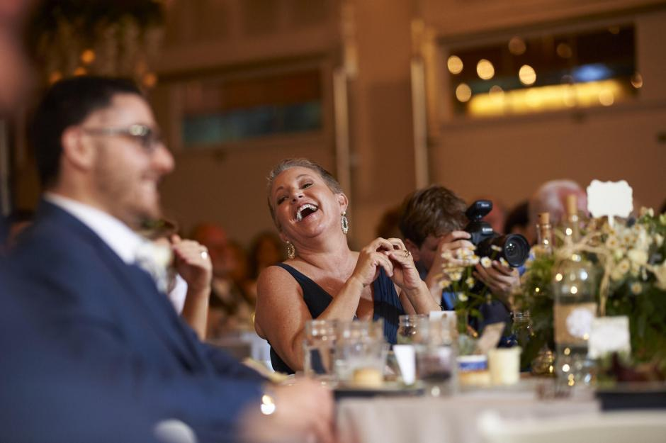 Bride's mom laughs during the wedding reception.