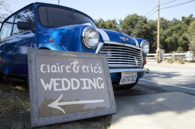 Wedding location sign with Eric's Mini Cooper.