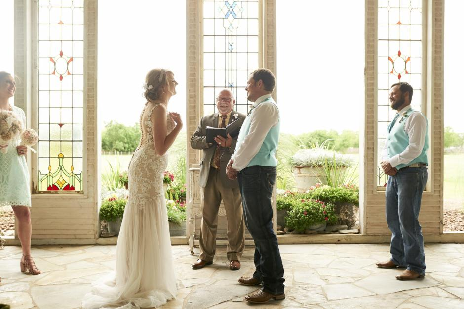 Bride excitely exchanges vows with groom at Gruene Estate's chapel.