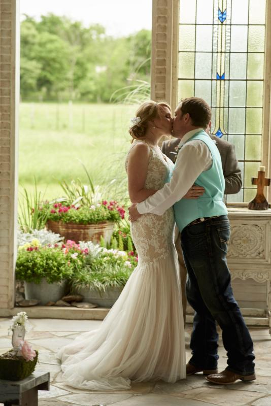 Bride and Groom have first kiss at Gruene Estate in New Braunfels