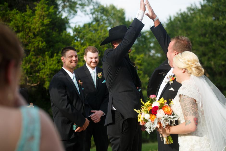 Groom high five at TerrAdorna wedding ceremony.