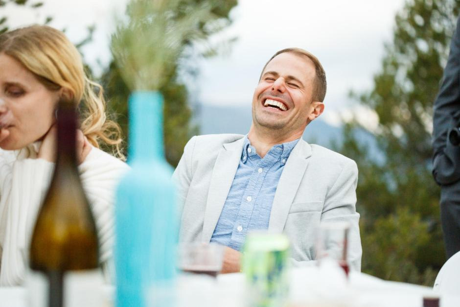 Guests laugh during the toast at Allison and Gabe's destination wedding.