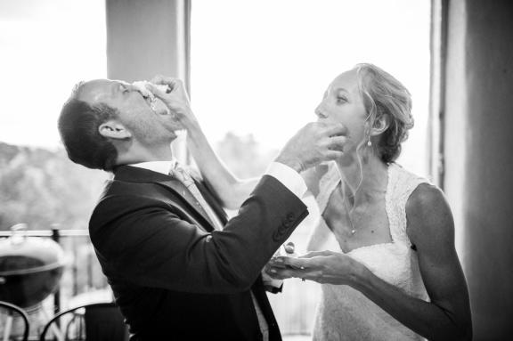 Allison smashes cake on Gabe's face at their Colorado wedding.