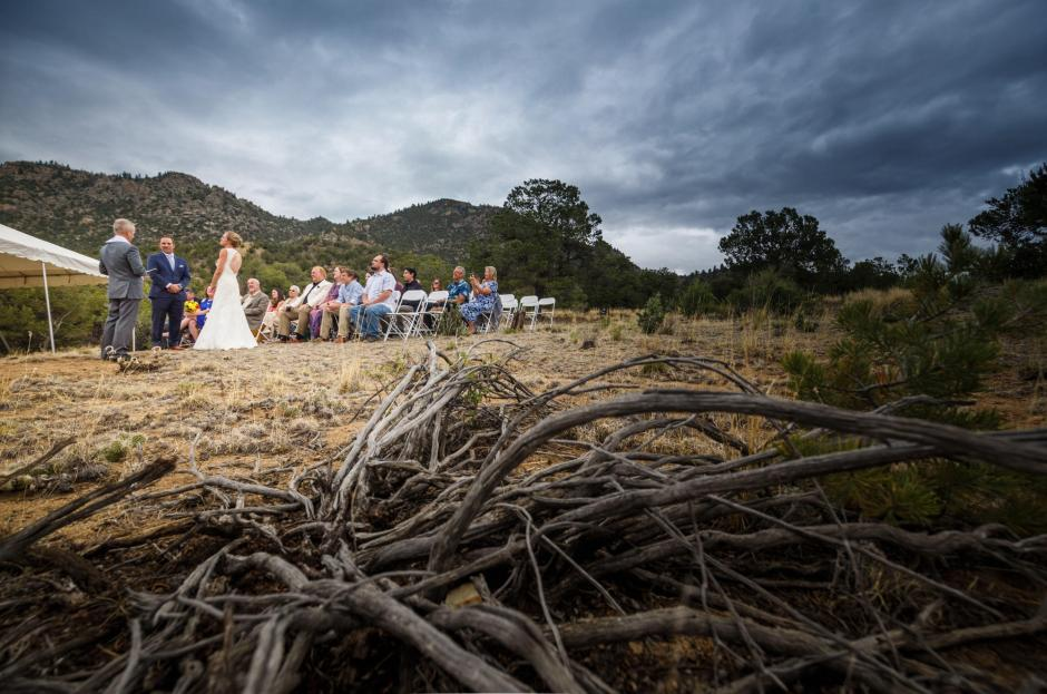 Allison and Gabe's wedding ceremony at camp endurance with stormy skies.