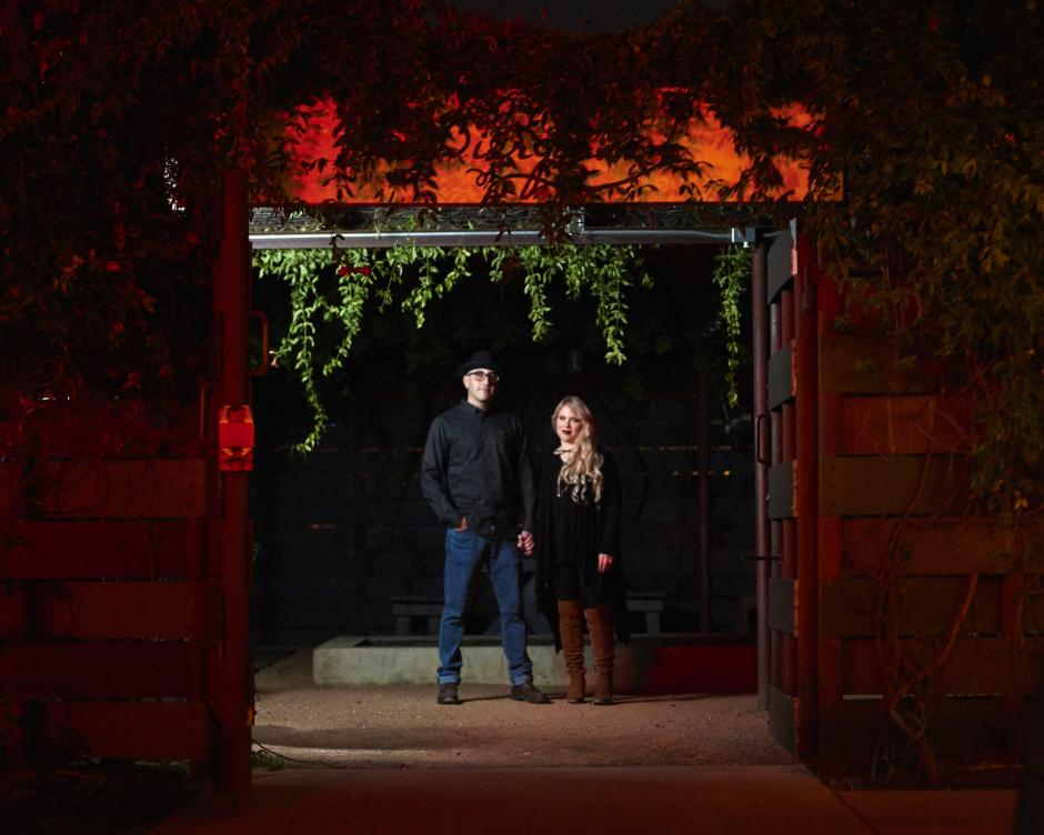 Downtown Georgetown Halloween Engagement Photos in Monument Cafe's Garden
