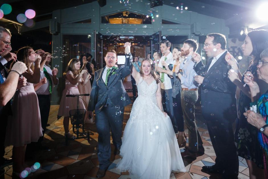 Joshua and Brittany Wedding - Bride and groom exiting after their UT Alumni Center wedding reception. Etter-Harbin Alumni Center.
