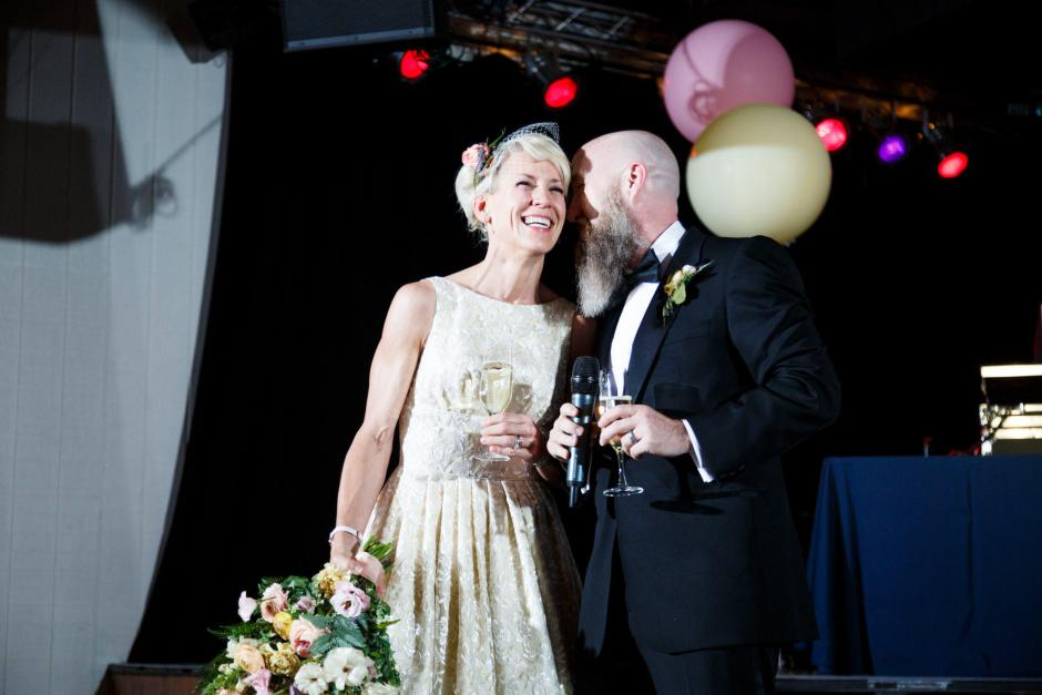 Mike and Kathie giving a toast during their Downtown Austin Palm Door on Sixth Wedding Reception