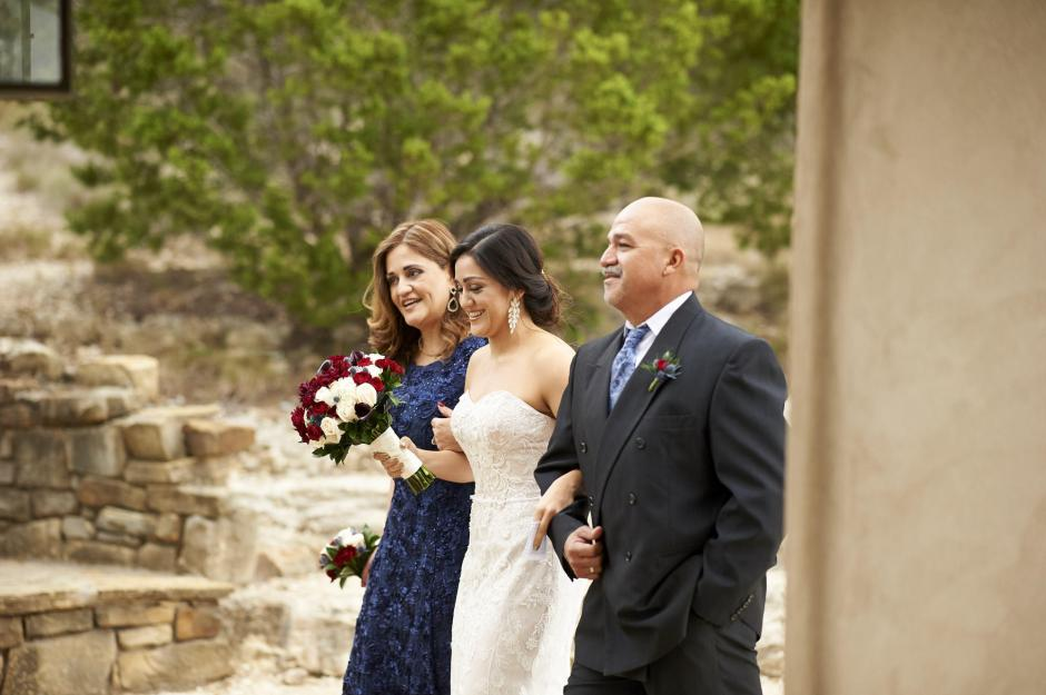 The bride walks in with her parents at a Chapel Dulcinea Wedding.