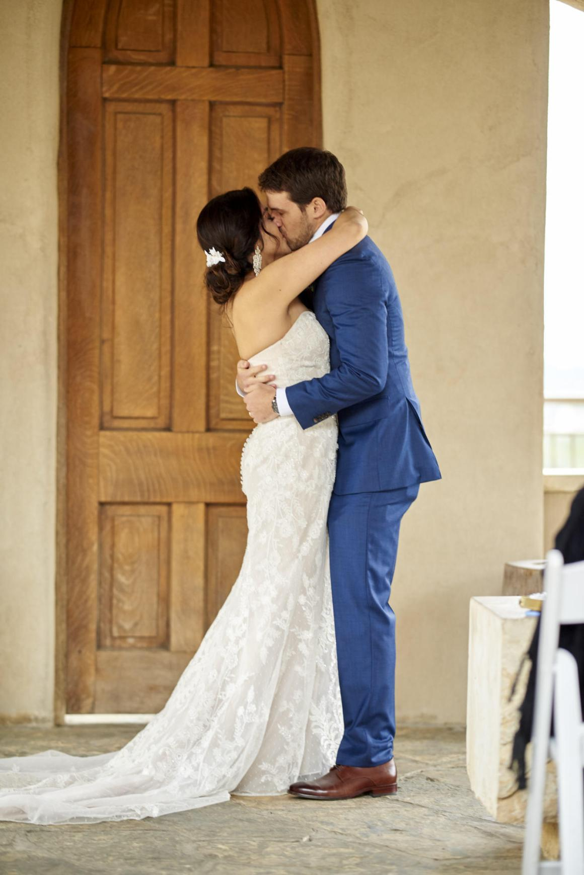 The bride and groom's first kiss after their wedding ceremony.