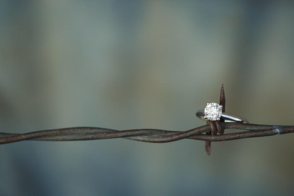 Haley and Hunter's engagement ring on a barb wire fence.