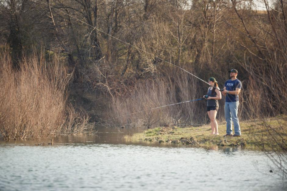 Hunter and Haley fishing along Little River during a Country Texas Outdoor Sportsman Engagement