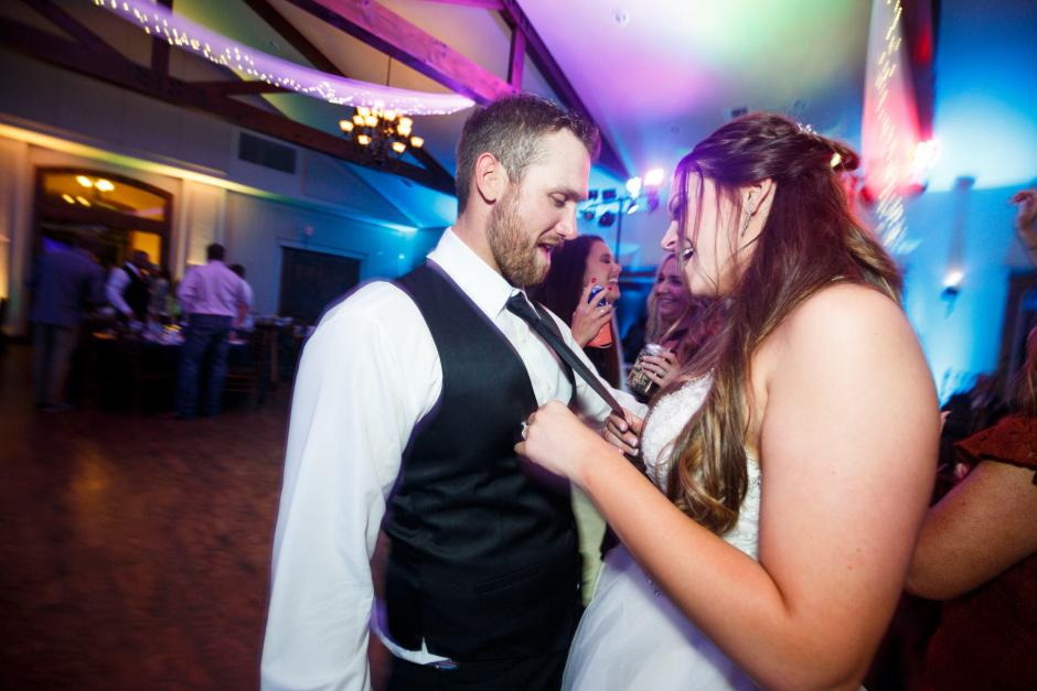 Bride dances with the groom during their Cathedral Oaks wedding reception.