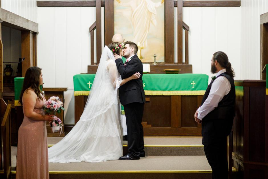 St Johns Lutheran Church Old Fashion Wedding ceremony - Austin and Meagan first kiss in Denhawken near San Antonio, Tx.