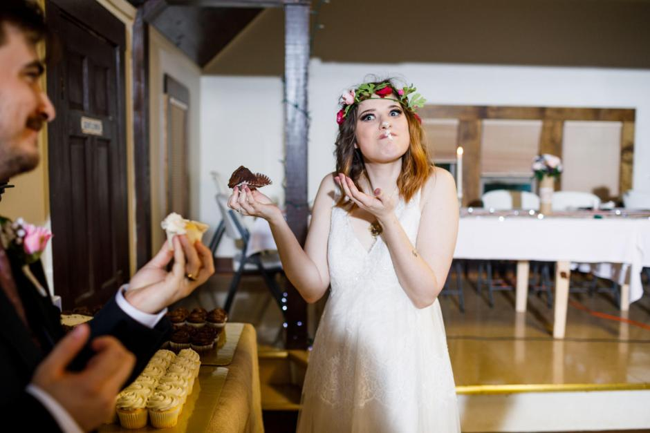 Austin and Meagan serve each other cupcakes at their old fashion wedding in Denhawken, Tx near San Antonio.